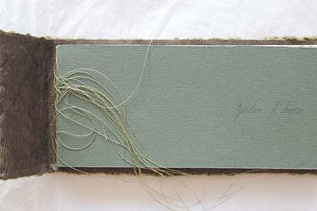 page de couverture cartonnée de couleur verte d'un livre d'artiste de Viviane Michel